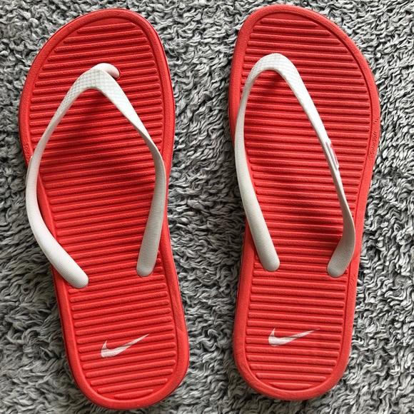 Nike Shoes - Nike - pink & white solarsoft flip flops!